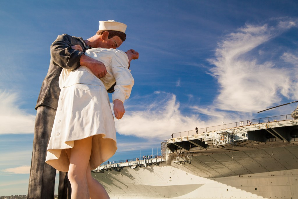 The Unconditional Surrender Statue in front of the USS Midway Museum