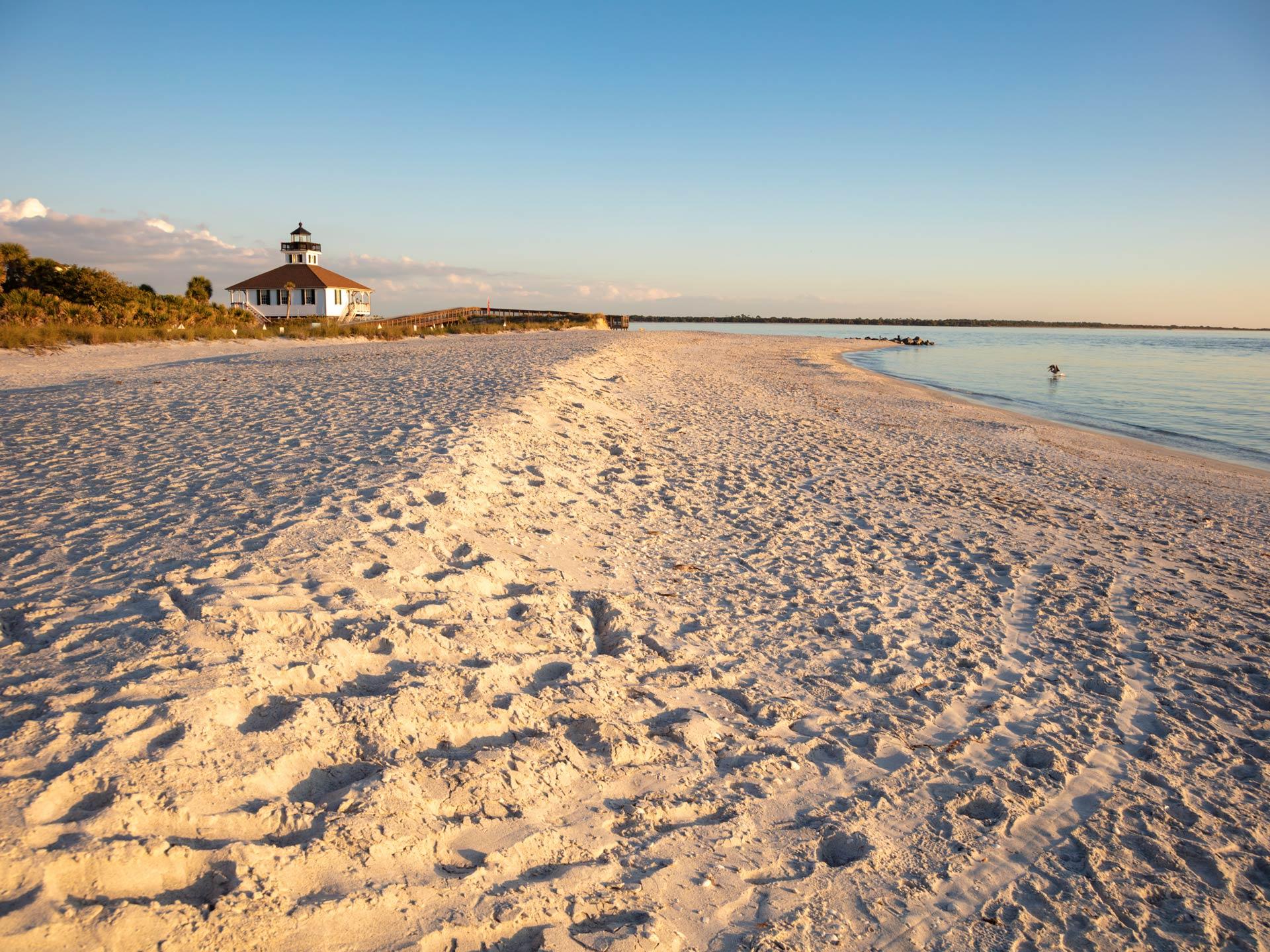 A beach in Boca Grande Florida, overlooking a lighthouse