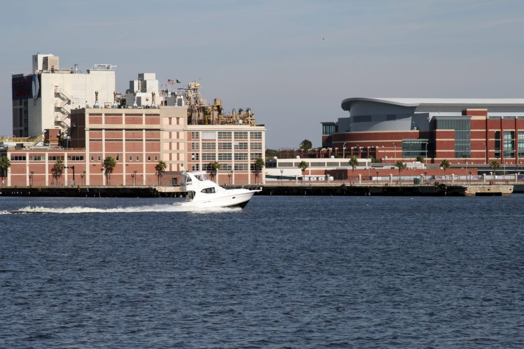 A charter boat cruises along the St Johns River