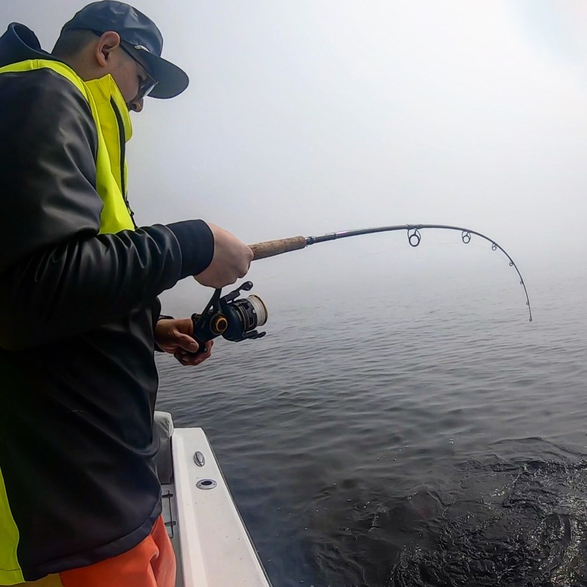 Catching fish in the fog can be alot of fun. Here's Max B. hooked up with a striped bass aboard Fish Head Charters.