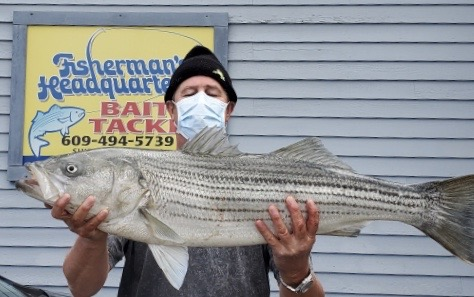 Kevin M. caught this 19.98 pound striped bass from the LBI surf on May 12 at about 11am. He was chunking bunker.