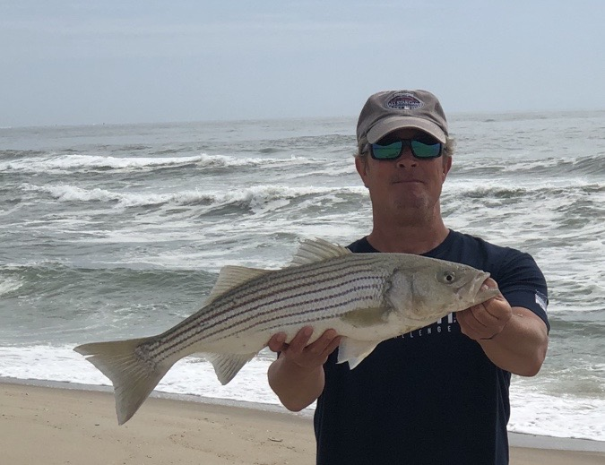 """Kevin McNeil caught and released a 27"""" striped bass off of the North End surf this morning on bunker."""