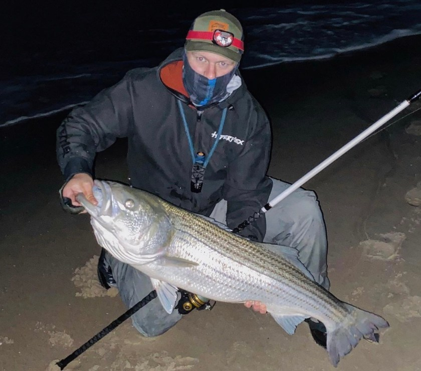 Surfcaster Josh Basket fished the pre dawn hours with fresh bunker chunks and caught this striped bass off the LBI surf on June 1, 2020.