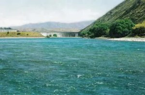 View of the Waitaki Dam from the mouth of the Awakino River. Fly fishing.
