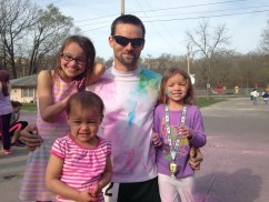 Run Club member Russell Wenz with daughters Cara, Cassie and Maddie at the 5K Tortoise and Hare fundraiser for the Good Samaritan Center on April 12, 2014.