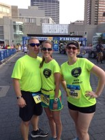 Eric & Sarah Wilson with Sarah Grosko at the starting line of the Hospital Hill 5K