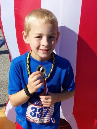 Parker Wilson, first in age group, third overall in the kids run.