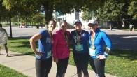 LeeJae Wansing and friends, Crystal Hochwender, Melissa Miller Bartlett and Krissi Richmond display their half marathon medals.