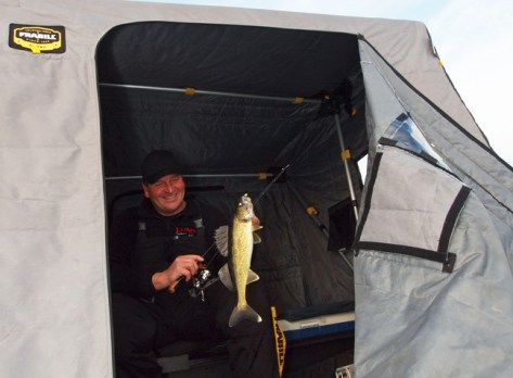 Although hole-hopping is part of Mark Brumbaugh's midwinter strategy, his goal is locating a walleye cruising lane to establish over in a comfy, thermal portable fish house.