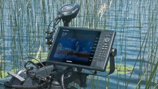 Check out the depth on the Garmin. When you find reed beds with pads in this kind of depth, get out the stick baits!
