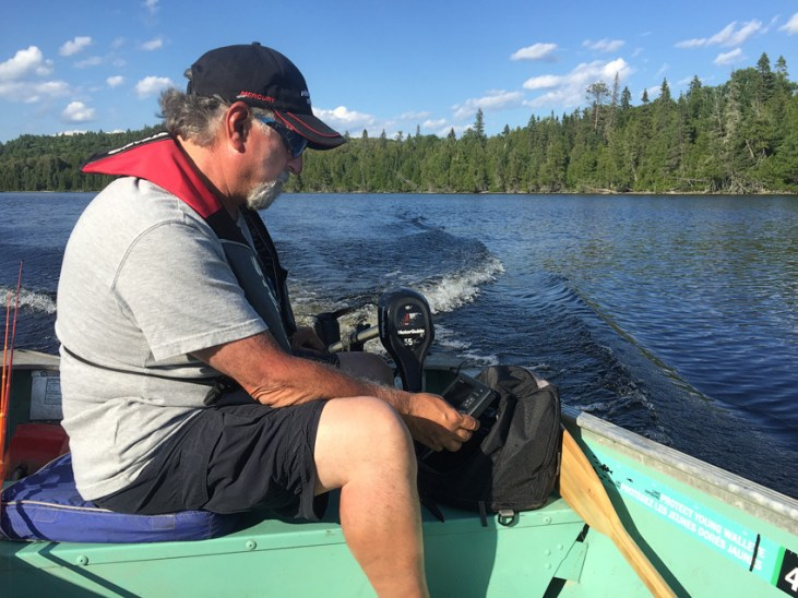 Angelo Viola is reading his portable Garmin Echomap unit. Even in small hard-to-get-to lakes, a fishfinder/gps is critical.