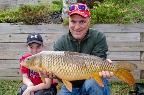 Lawrence and Victor display their father-son carp catch
