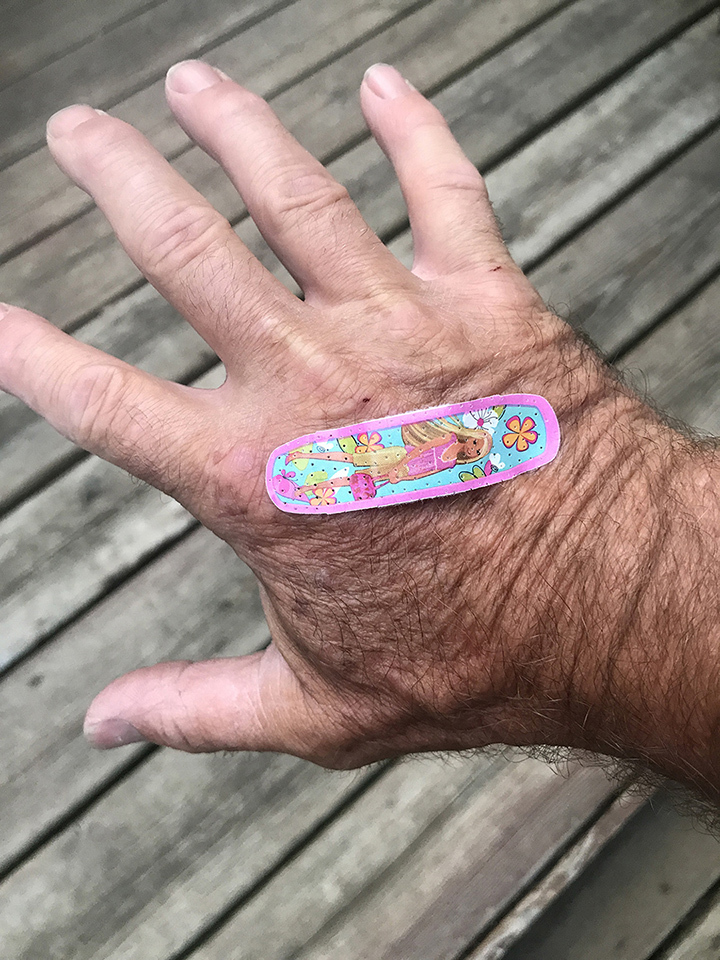 Bandaid on hand