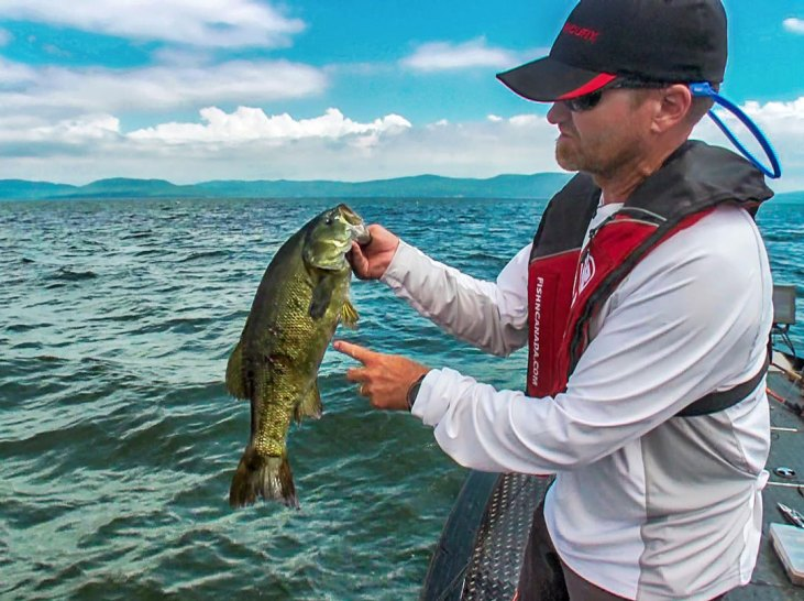 Although Pete Bowman is pointing out the markings on his Smallmouth, he should be pointing at that gorgeous, mountainous, Lake Superior scenery in the background.