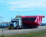 This monster wide load, one of two such loads traveling together, blocked both lanes of westbound traffic just after we entered Wyoming. They were accompanied by at least a half dozen pilot vehicles that controlled traffic which was lined up behind them.