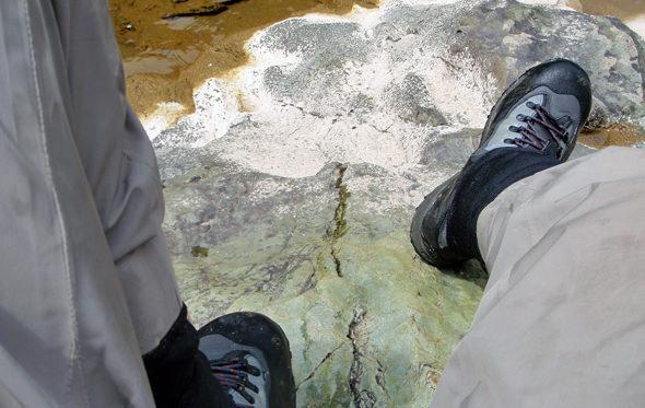 Sliding down a smooth boulder...never fun in wet felt!