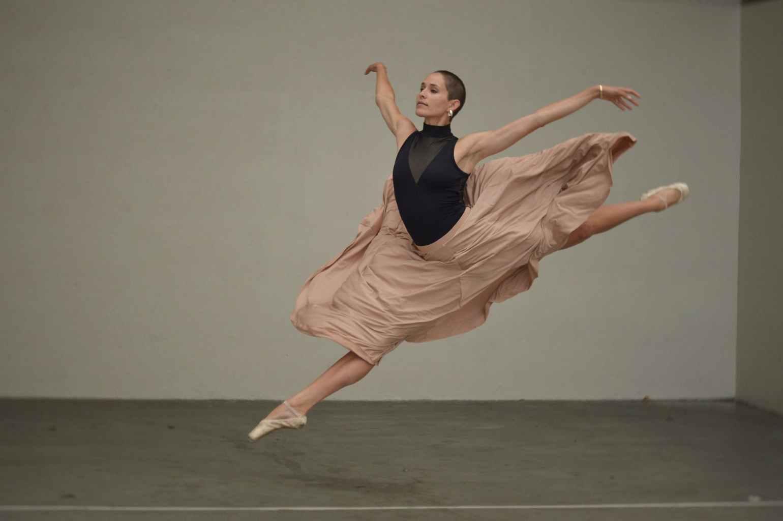 muscular female dancer rehearsing in spacious studio