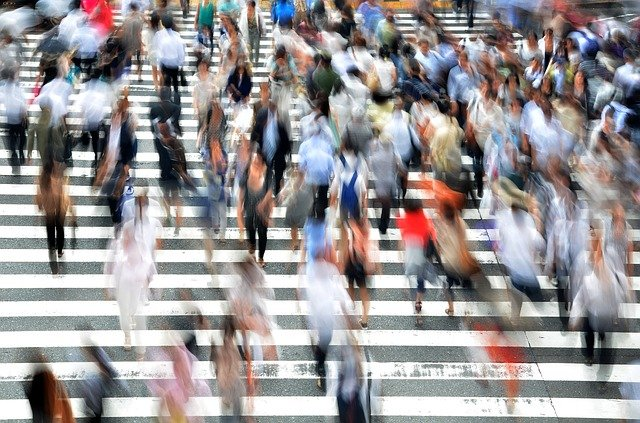 blurred picture of busy people crossing the street