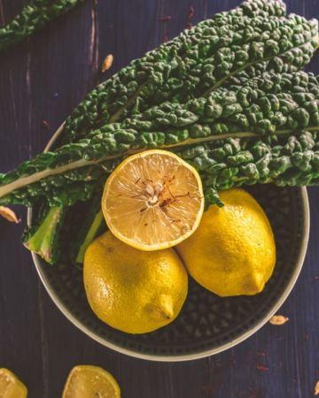 bowl of lemons and greens