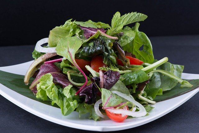 Fill your plate with a salad of greens dressed with olive oil and balsamic vinegar.