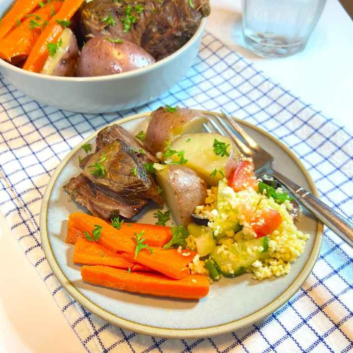 Slow cooker pot roast with vegetables on plate
