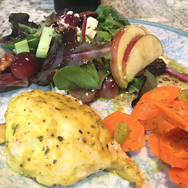 Add apple pecan salad to a plate of honey mustard chicken and carrots and celery.