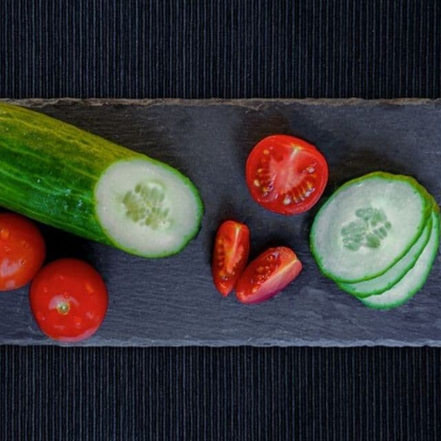 Chopped cucumber and tomato for Mediterranean Salad