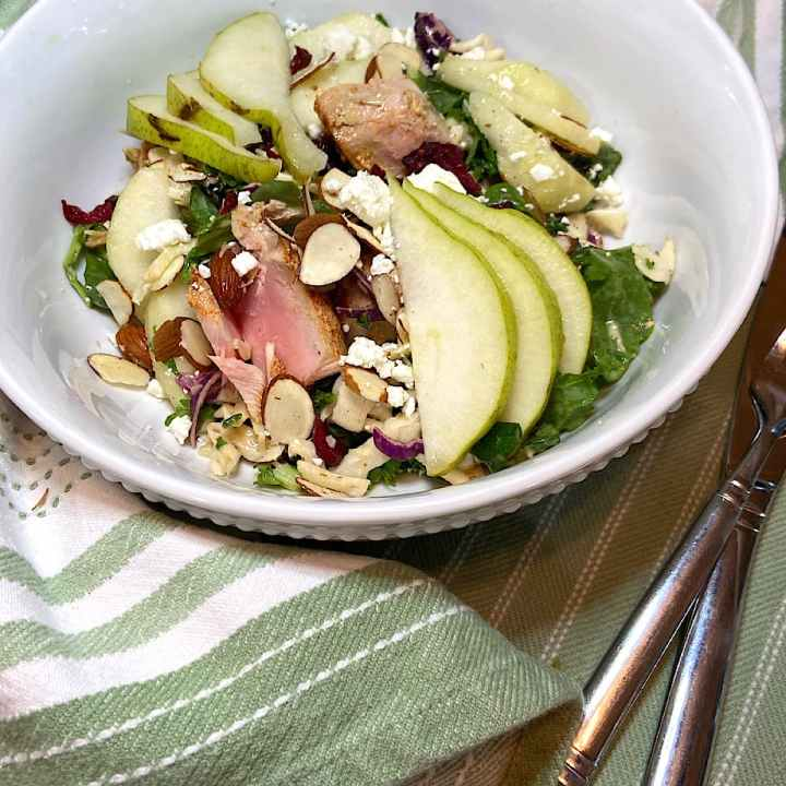 Grilled yellowfin tuna and pear salad in bowl ready to searve