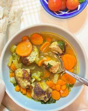turkey meatball kale soup in a bowl