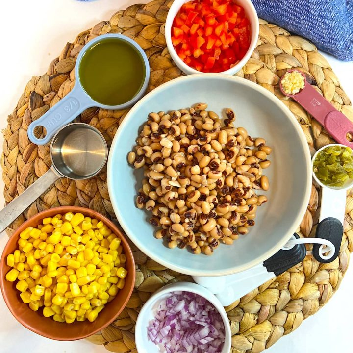 spread of measured ingredients for corn and black eyed pea dip