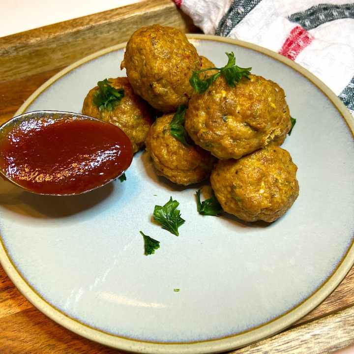 Tasty Mediterranean Meatballs on plate with sauce.
