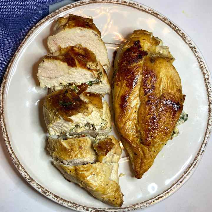 Spinach and Feta Stuffed Chicken Breast sliced on plate ready to serve