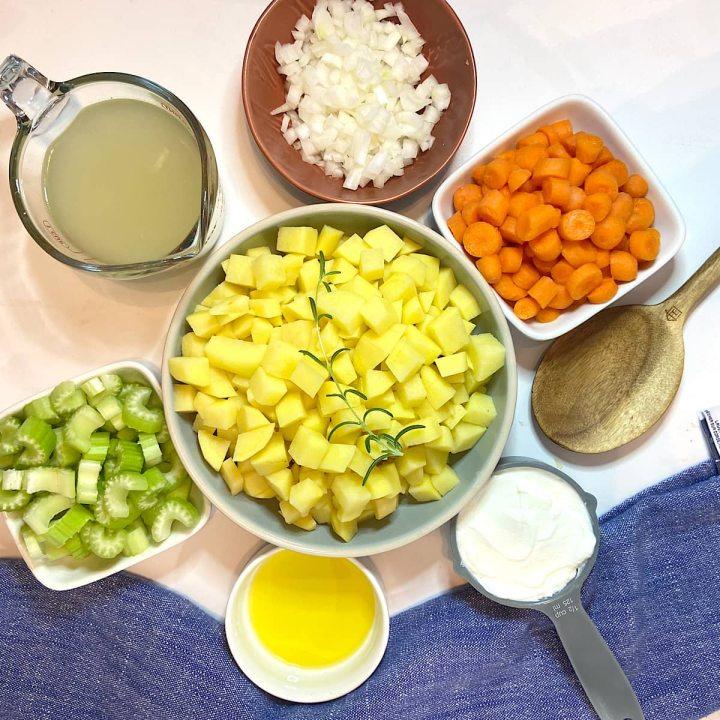 spread of measured potato soup ingredients