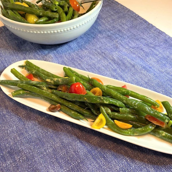 Green beans tomatoes ready to serve on plate