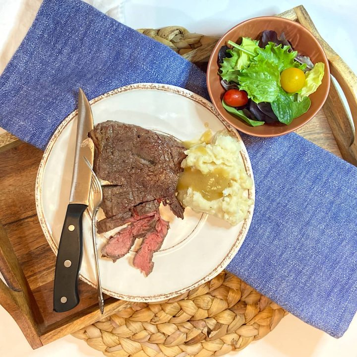 Steak made with best steak marinade with mashed potatoes, and green salad