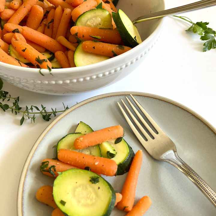 baby carrots with zucchini on plate and in bowl