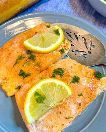 salmon with lemon on plate