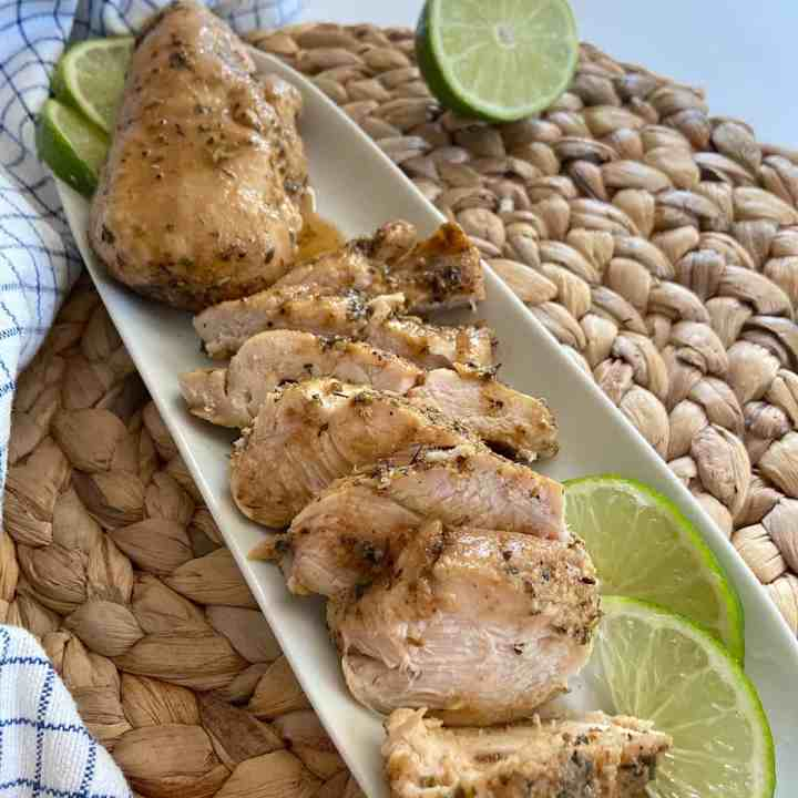 Spice baked chicken on a serving dish.