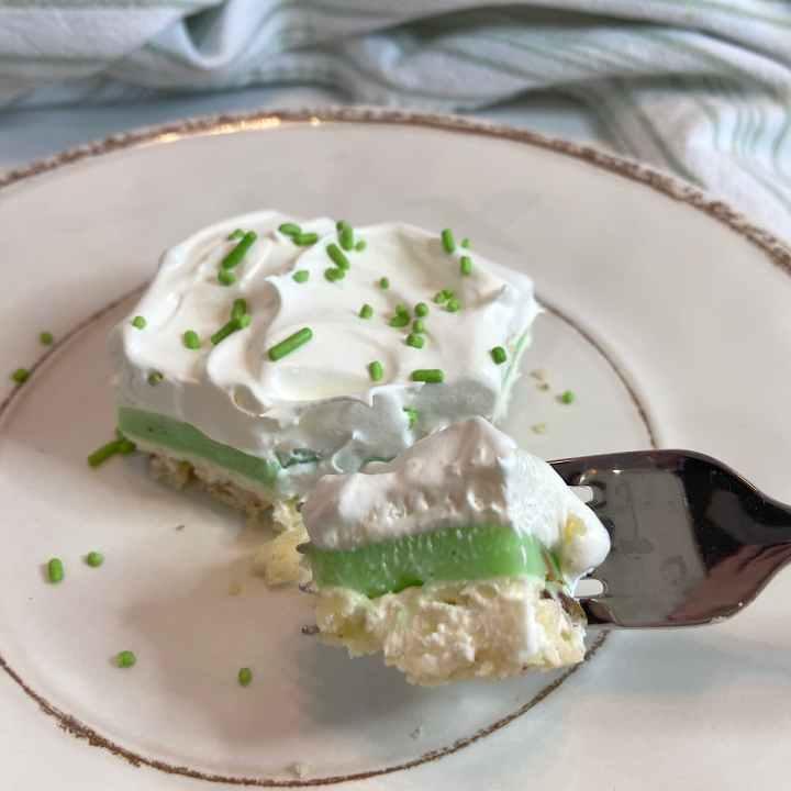 slice of pistachio pudding dessert on plate