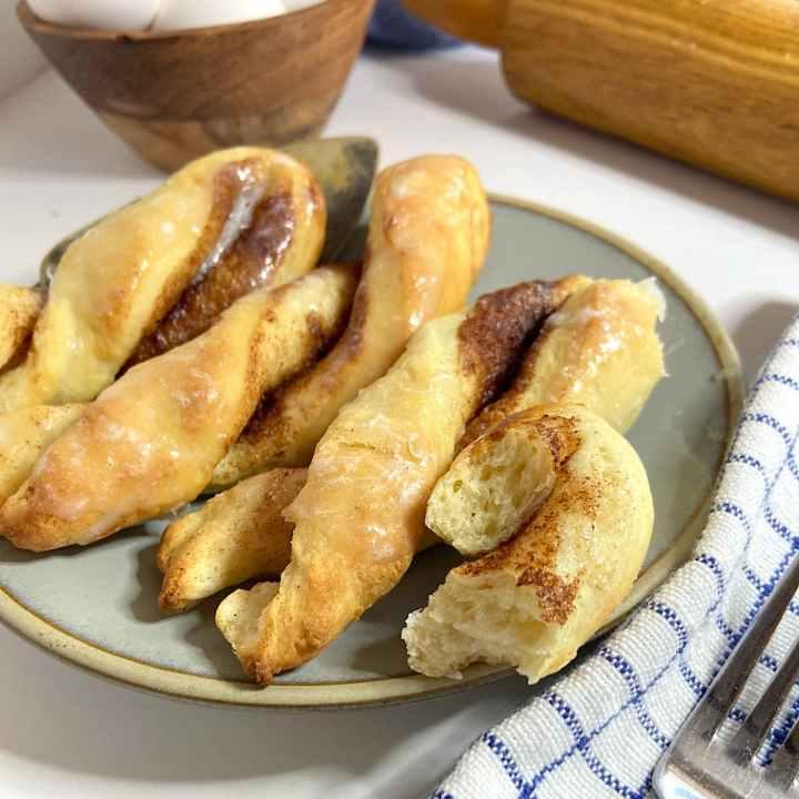 Fresh baked cinnamon roll twists on a plate