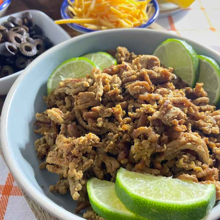 Ground turkey taco meat in bowl and toppings