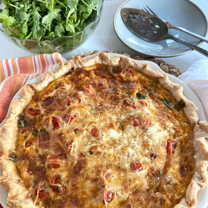 Fresh baked quiche with arugula salad