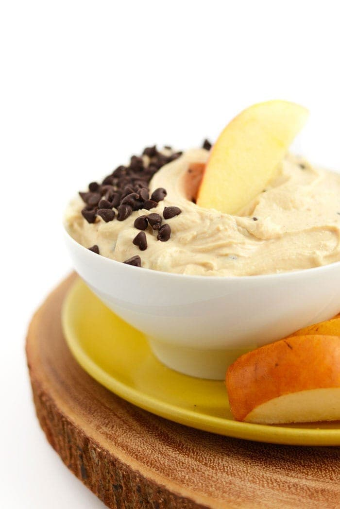 peanut butter greek yogurt dip in a bowl with chocolate chips