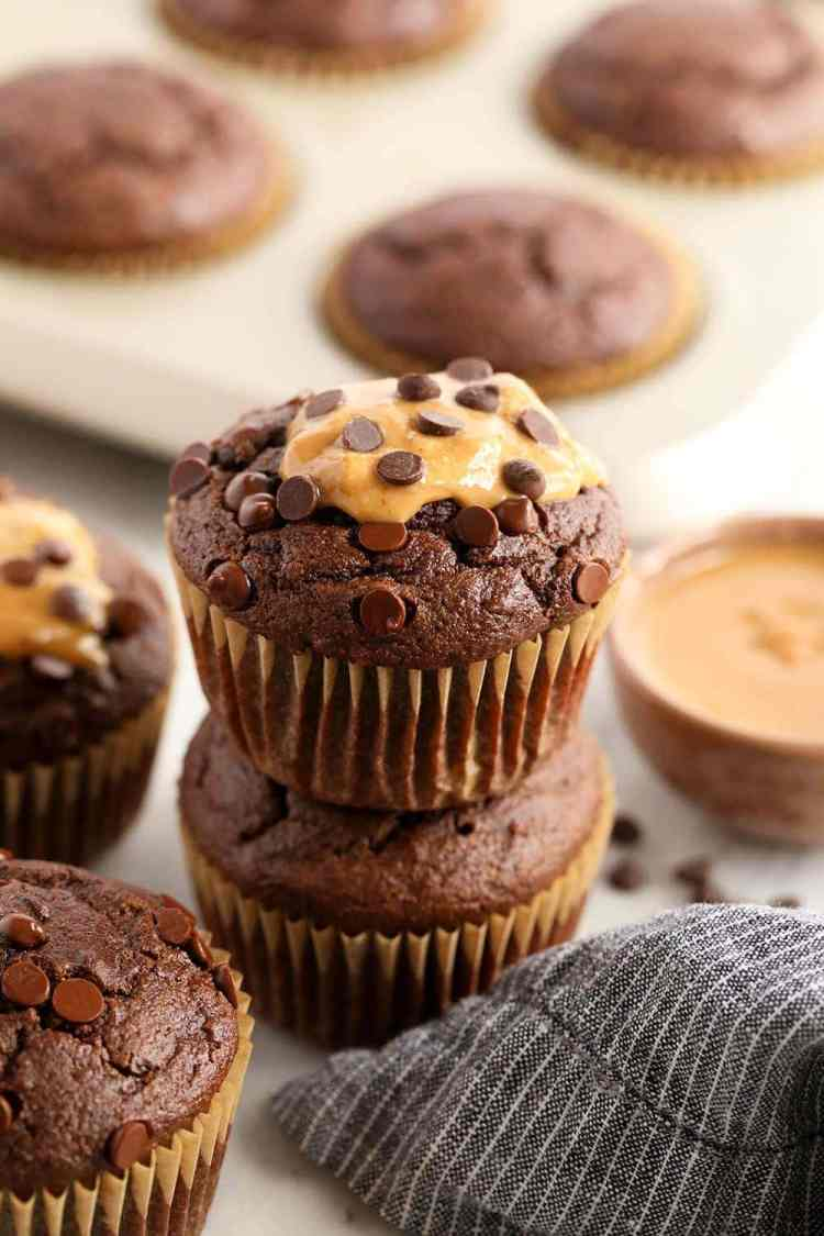 healthy chocolate peanut butter muffins stacked