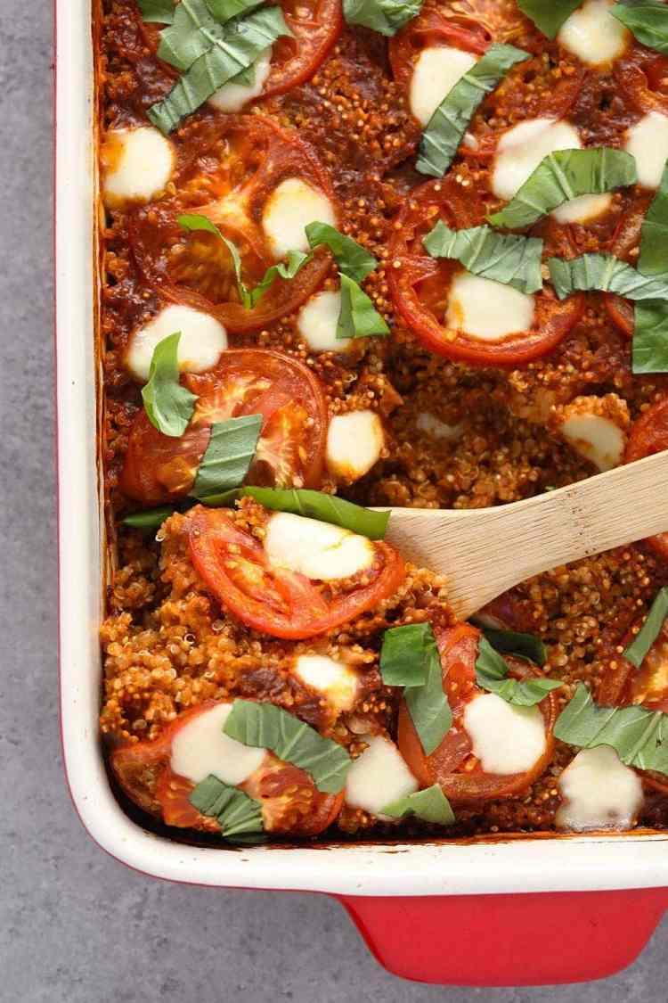 Tuscan chicken quinoa casserole with tomatoes, mozzarella and fresh basil