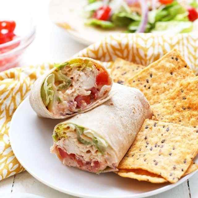 healthy chicken wrap with buffalo chicken and chips on plate