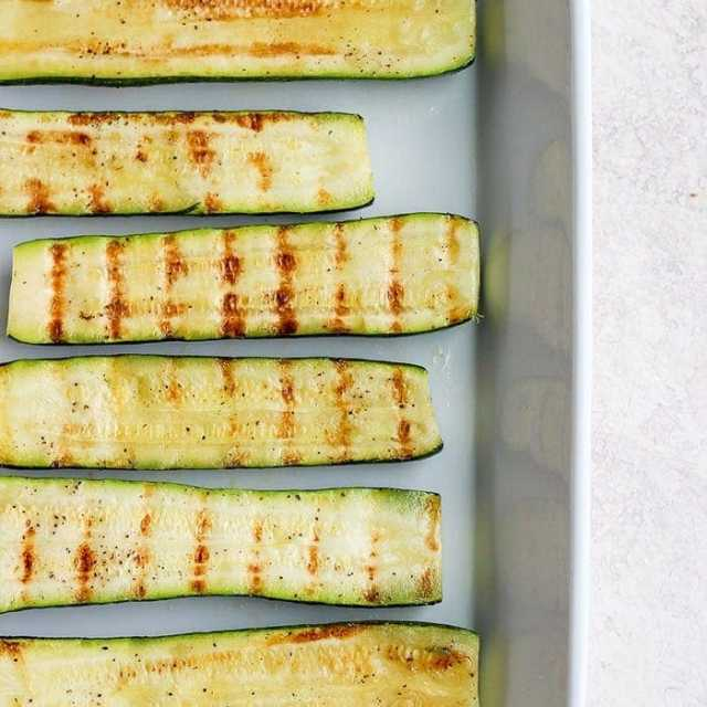 Grilled zucchini on a baking sheet.
