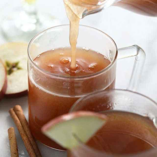 spiked apple cider in a glass mug