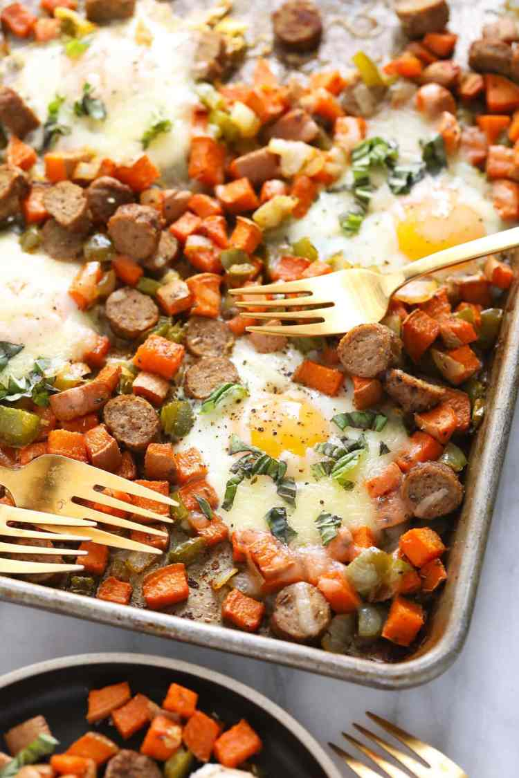 sweet potato hash on baking sheet with forks