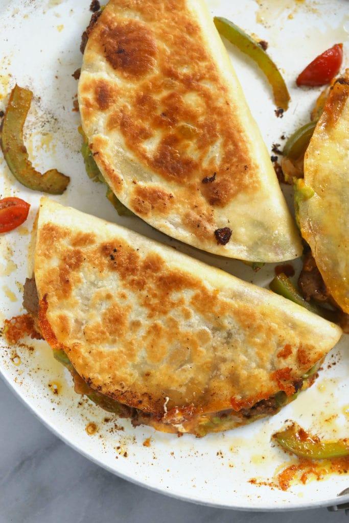 Pan fried chicken quesadilla in a pan